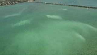 AX0026_051 - 5K stock footage aerial video of flying over murky water off the shore of Little Torch Key, Florida