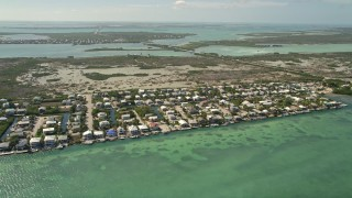 AX0026_052 - 5K stock footage aerial video of flying over homes along the shore, wetlands, Little Torch Key, Florida
