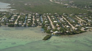 AX0026_053 - 5K aerial stock footage video of approaching homes and canals, Ramrod Key, Florida