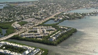 AX0026_064 - 5K stock footage aerial video of flying by condominiums on the shore of Key West, Florida