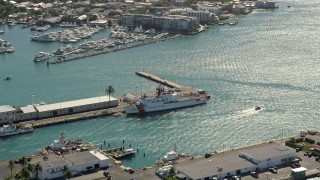AX0026_067 - 5K stock footage aerial video of flying by US Coast Guard ship docked at Trumbo Point, Key West, Florida