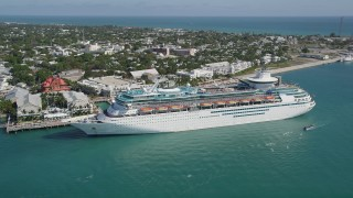AX0026_070 - 5K stock footage aerial video of a Royal Caribbean cruise ship, docked in Key West, Florida