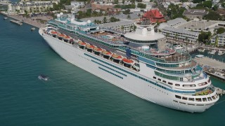 AX0026_072 - 5K stock footage aerial video of approaching a Royal Caribbean Cruise Ship, docked, Key West, Florida