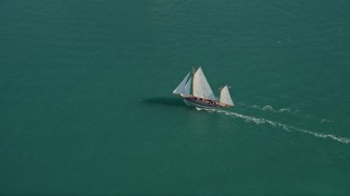 AX0026_074 - 5K stock footage aerial video of a sailboat off the shore of Key West, Florida