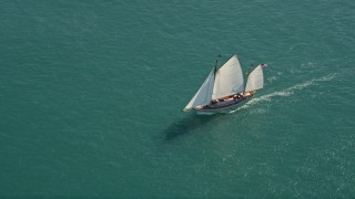 AX0026_075 - 5K stock footage aerial video of a sailboat on the ocean near Key West, Florida