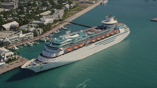 AX0026_077 - 5K stock footage aerial video of flying by Royal Caribbean Cruise Ship in Key West, Florida