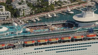 AX0026_078 - 5K stock footage aerial video fly by sunbathers at pool on Royal Caribbean Cruise Ship, Key West, Florida