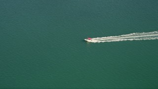 AX0026_084 - 5K stock footage aerial video of tracking a speedboat off the shore of Key West, Florida