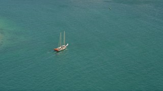 AX0026_094 - 5K stock footage aerial video of tracking a sailboat on the open water by Key West, Florida