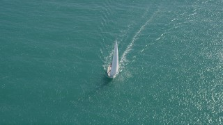 AX0026_098 - 5K stock footage aerial video of circling a sailboat near Key West, Florida