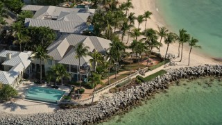 AX0026_103 - 5K stock footage aerial video of orbiting homes on the shore of Sunset Key by Key West, Florida