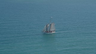 AX0026_104 - 5K stock footage aerial video of tracking a sailboat near Key West, Florida