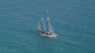 AX0026_105 - 5K stock footage aerial video of circling a sailboat crossing the ocean near Key West, Florida