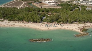 AX0026_110 - 5K stock footage aerial video of sunbathers by Fort Zachary Taylor Historic State Park, Key West, Florida