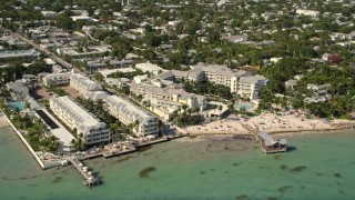 AX0026_114 - 5K stock footage aerial video of The Reach - A Waldorf Astoria Resort on the shore of Key West, Florida
