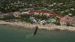 AX0027_008 - 5K stock footage aerial video of flying by the Casa Marina, Key West, Florida