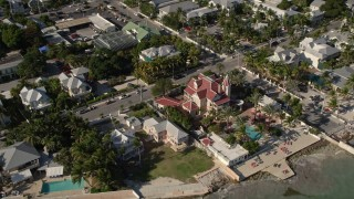 AX0027_010 - 5K stock footage aerial video of flying by the Southernmost House Historic Inn, Key West, Florida