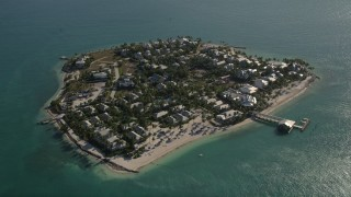 AX0027_016 - 5K stock footage aerial video of approaching homes on Sunset Key, Key West, Florida
