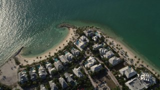 AX0027_017 - 5K stock footage aerial video of flying by homes along the beach, Sunset Key, Key West, Florida
