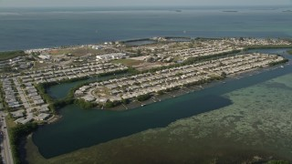 AX0027_028 - 5K stock footage aerial video of flying by Sigsbee Park, Key West, Florida