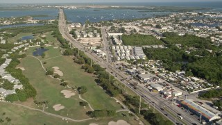 AX0027_031 - 5K stock footage aerial video of following Overseas Highway through Stock Island, Key West, Florida