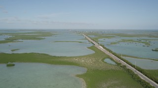 AX0027_045 - 5K stock footage aerial video of following Overseas Highway, Saddlebunch Keys, Florida