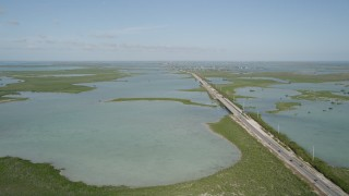 AX0027_046 - 5K stock footage aerial video of following Overseas Highway, Saddlebunch Keys, Florida