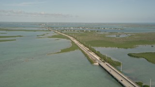 AX0027_047 - 5K stock footage aerial video of following Overseas Highway, Saddlebunch Keys, Florida