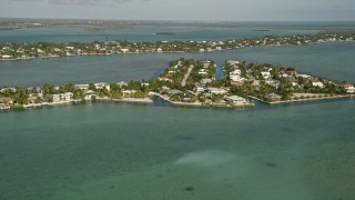 AX0027_048 - 5K stock footage aerial video of approaching residential neighborhoods, Lower Sugarloaf Key, Florida