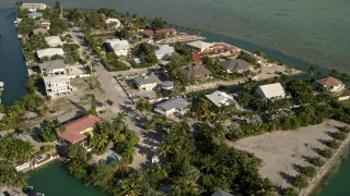 AX0027_049 - 5K stock footage aerial video of flying over residential neighborhood, tilt down, Lower Sugarloaf Key, Florida