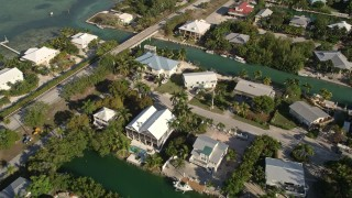 AX0027_051 - 5K stock footage aerial video of flying over homes near the shore of Lower Sugarloaf Key, Florida