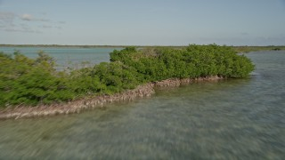 AX0027_053 - 5K stock footage aerial video of approaching and flying over mangroves, Upper Sugarloaf Sound, Florida