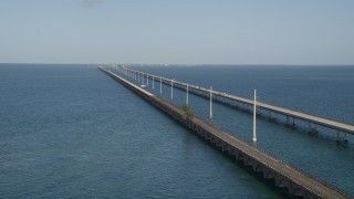 AX0027_076 - 5K stock footage aerial video of approaching light traffic on Seven Mile Bridge, Florida