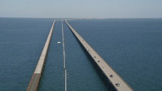 AX0027_077 - 5K stock footage aerial video of flying by light traffic on Seven Mile Bridge, Florida