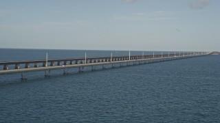 AX0027_079 - 5K stock footage aerial video of light automobile traffic on the Seven Mile Bridge, Florida