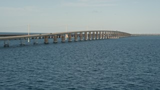AX0027_080 - 5K stock footage aerial video of flying by a rise in Seven Mile Bridge, Florida