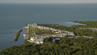 AX0028_002 - 5K stock footage aerial video of flying by Indigo Reef Vacation Rentals on the shore, Marathon, Florida