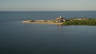 AX0028_003 - 5K stock footage aerial video of flying by the coast, near a mansion, Marathon, Florida