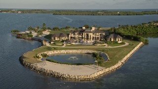 AX0028_004 - 5K stock footage aerial video of orbiting mansion on the shore, Marathon, Florida