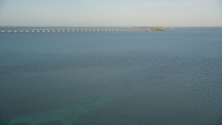 AX0028_018 - 5K stock footage aerial video of approaching bridge on Overseas Highway at sunset, Long Key, Florida