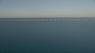 AX0028_019 - 5K stock footage aerial video of approaching bridge at sunset on Overseas Highway, Long Key, Florida