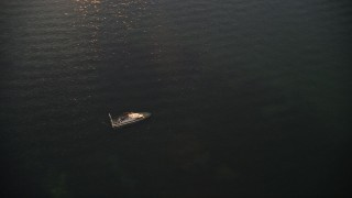 AX0028_036 - 5K stock footage aerial video of orbiting a sunken speedboat at sunset, Key Largo, Florida