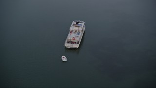 AX0028_040 - 5K stock footage aerial video of orbiting a houseboat near shore at sunset, Key Largo, Florida