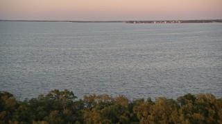 AX0028_041 - 5K stock footage aerial video of flying over mangroves and a bay at sunset, Key Largo, Florida