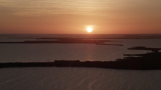 AX0028_043 - 5K stock footage aerial video of flying by bays and mangroves, Key Largo, Florida, sunset