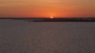 AX0028_047 - 5K stock footage aerial video of ascending over the water, Key Largo, Florida, sunset