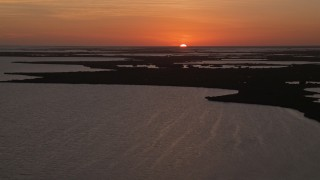 AX0028_048 - 5K stock footage aerial video of flying by mangroves and bays, Key Largo, Florida, sunset