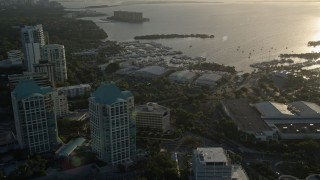 AX0029_006 - 5K stock footage aerial video fly over office buildings, approach yacht clubs, Coconut Grove, Florida, sunrise