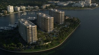 AX0029_008 - 5K stock footage aerial video flyby condominium complexes on Grove Isle, Florida, sunrise