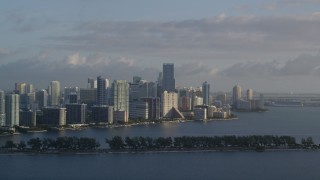 AX0029_009 - 5K stock footage aerial video of flying by Downtown Miami skyline, Florida, sunrise